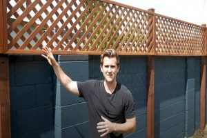 Installing a privacy fence on top of the concrete wall in Glendale
