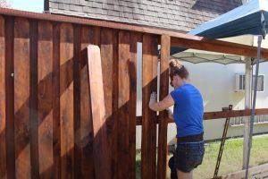 Glendale Fence worker installing a wood fence